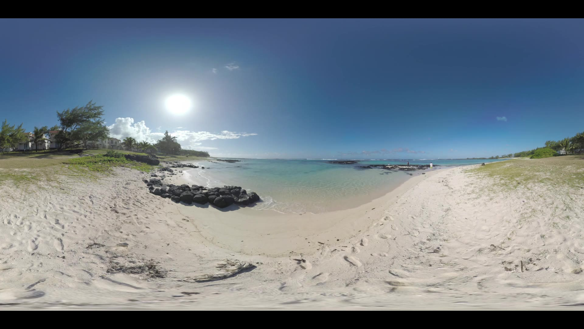 360 VR video. Blue ocean panorama and view of the beach with cottages alongside. Family spending bright sunny day outdoor and exploring black rocks on the coast. Mauritius scene