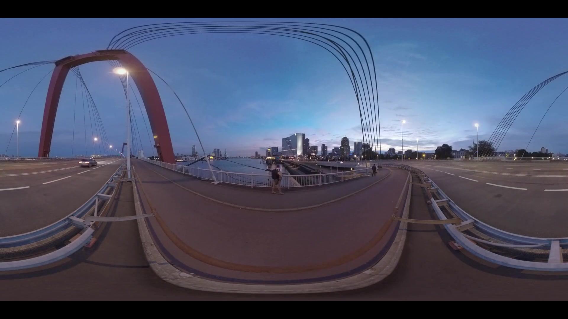 360 VR video. City buildings, river and transport traffic on Willemsbrug at night. Tourist with backpack (with model release) enjoying the view from the bridge