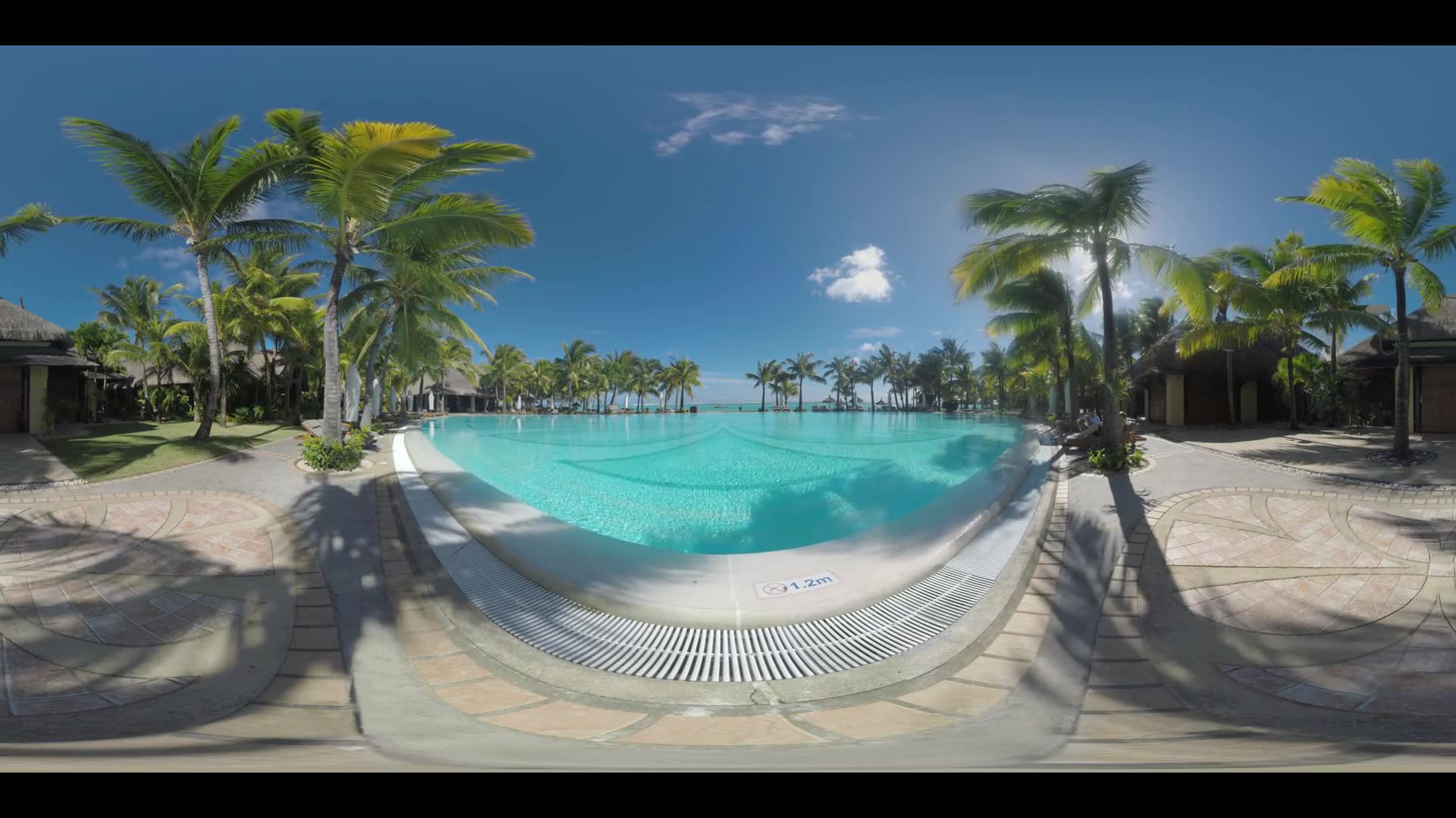 360 VR video. Swimming pool with palms and guest houses around. Couple relaxing on chaise-longues near the water. Vacation on tropical resort in Mauritius
