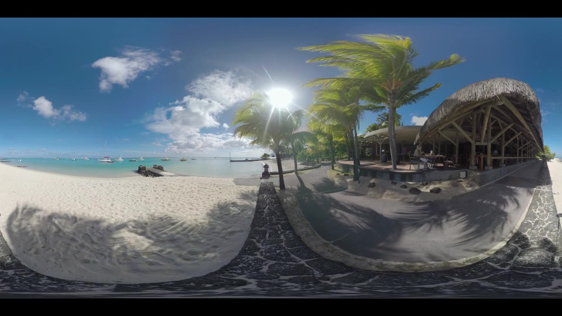 360 VR video. View to the clear blue ocean with yachts and white sand beach with palms. Family having dinner at the restaurant on the coast, Mauritius