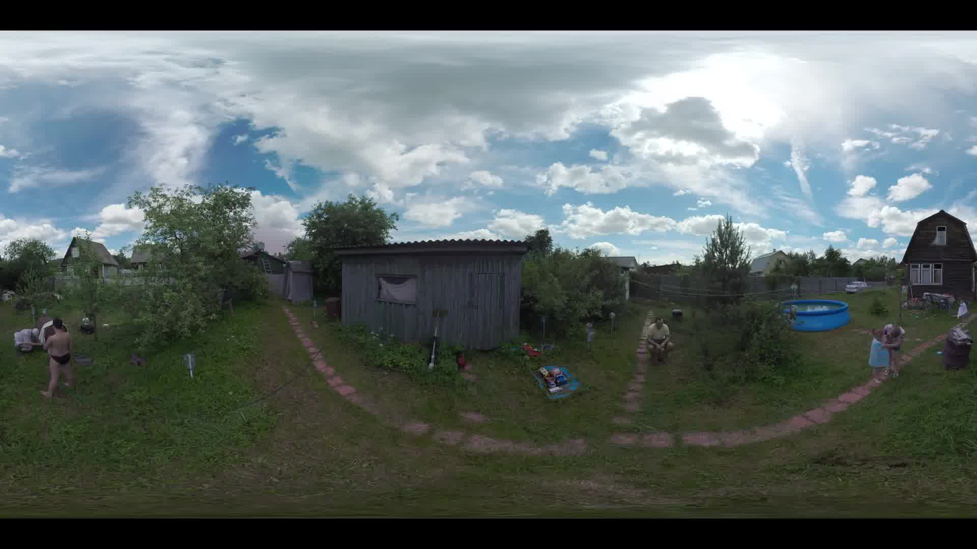 360 VR video. Wooden country house and family in the yard. Children wrapping into the towels after swimming in the outdoor pool. Leisure in the countryside. Ruza in Moscow region, Russia