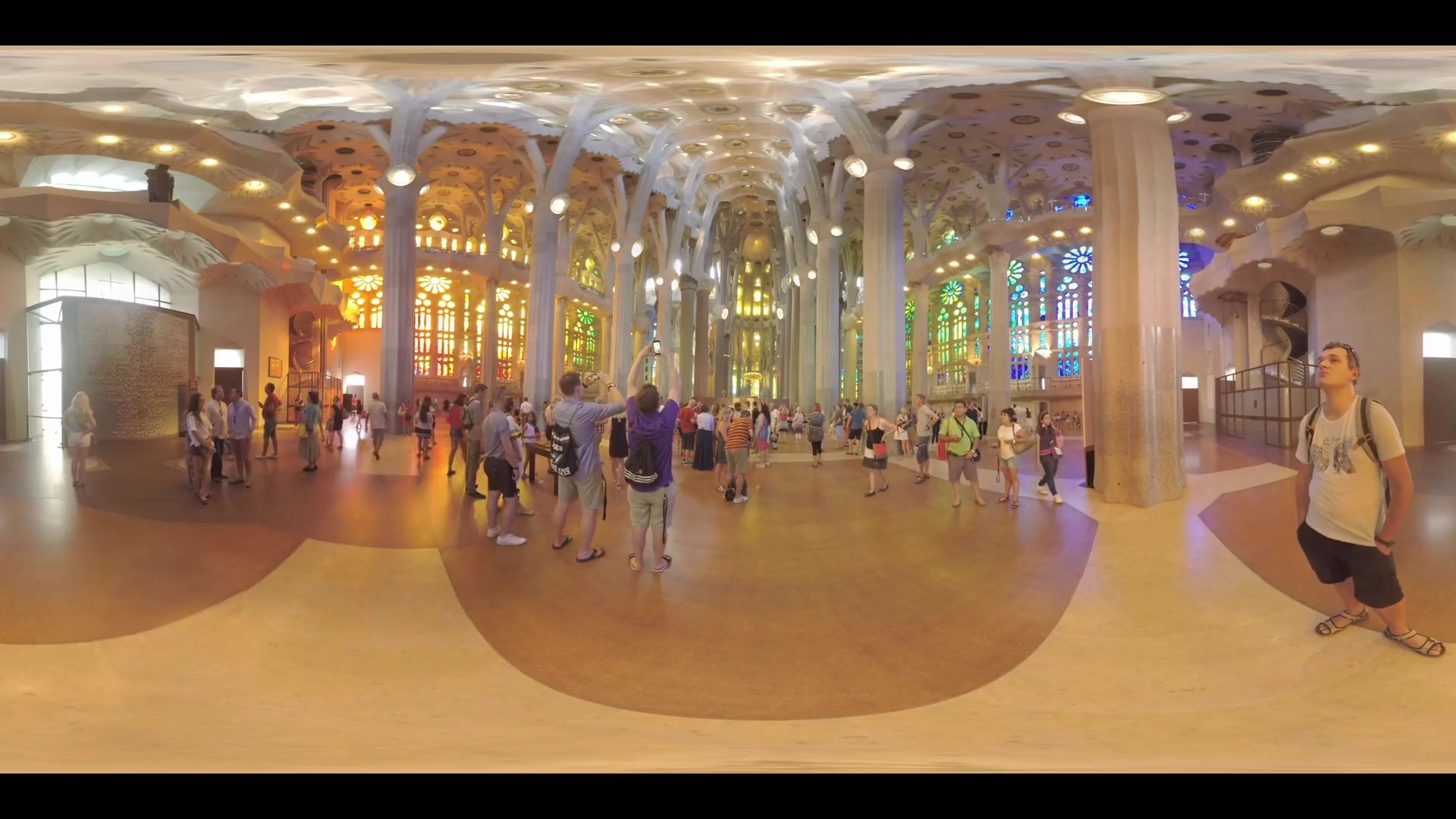 360 VR Visitors enjoying unique architecture inside Sagrada Familia, Barcelona