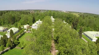 Flying over a manse with green outdoor space and treeline path. Scene of Tsaritsyno museum and reserve in Moscow