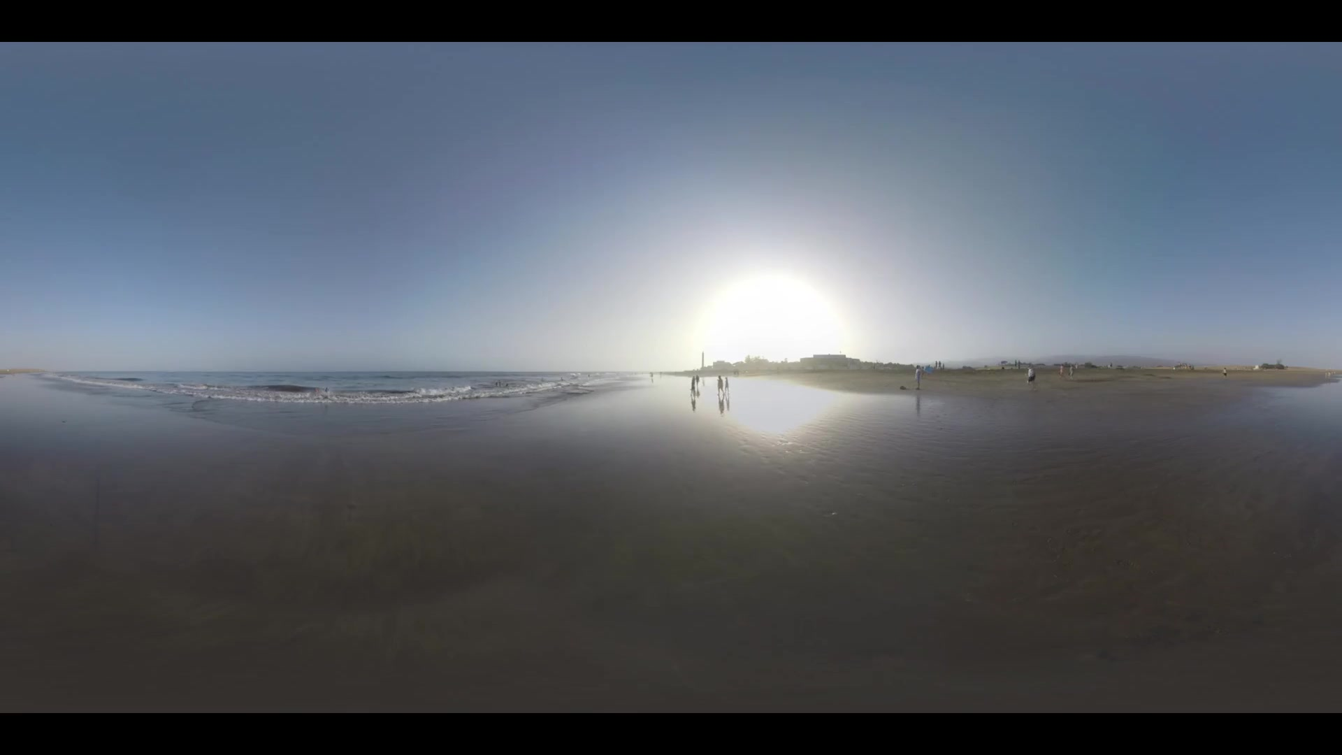 GRAN CANARIA, CANARY ISLANDS - AUGUST 02, 2016: 360 VR Video. Ocean beach line with walking people. Scene at sunset with distant Maspalomas Dunes and resort. Vacation on Gran Canaria