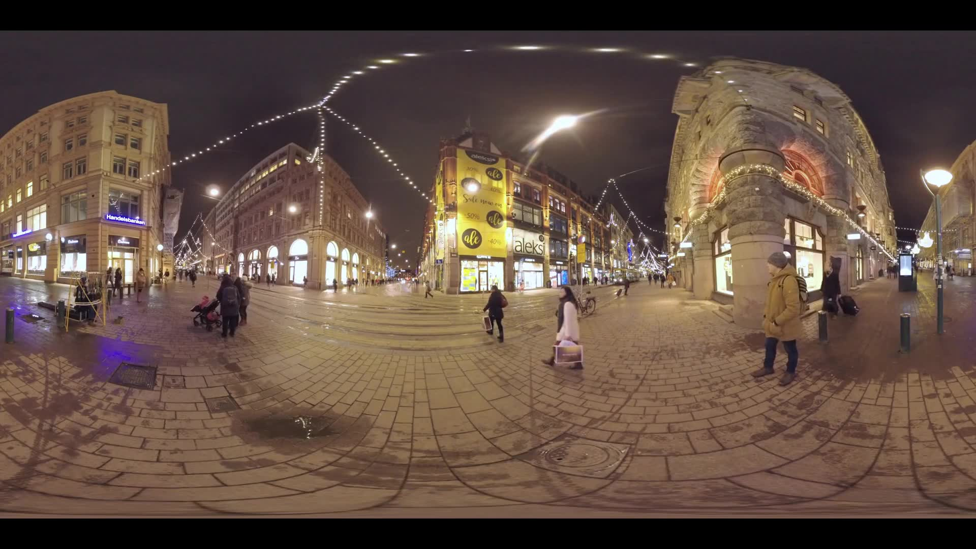 HELSINKI, FINLAND- JANUARY 05, 2016: 360 VR video. Night cityscape with people walking and tram traveling in Aleksanterinkatu street illuminated with stores and Christmas lights