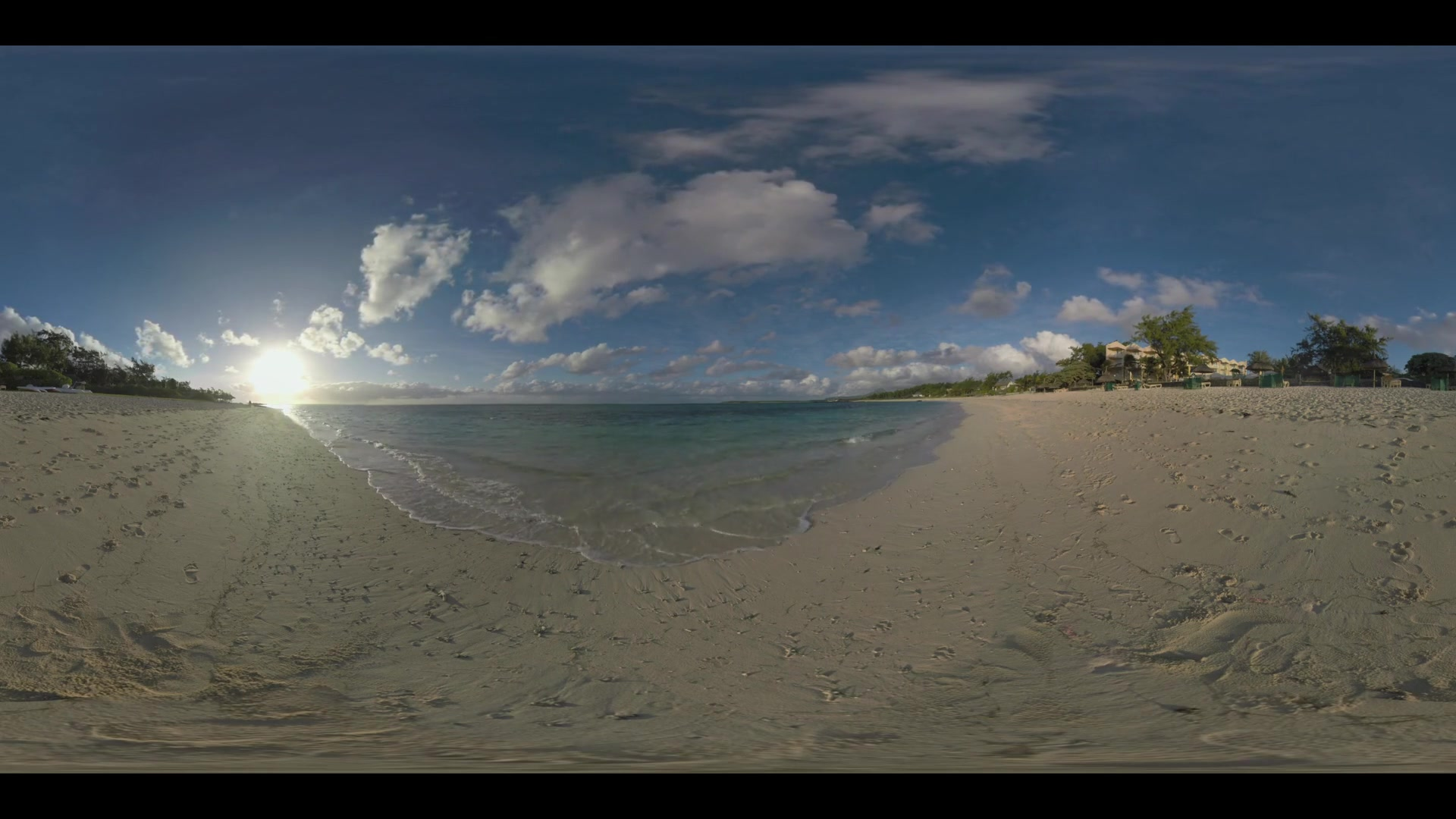 MAURITIUS ISLAND - JUNE 08, 2016: 360 VR video. Vacation scene of Mauritius. Blue ocean skyline and bright sun with sandy beach, resort on the coast and man walking along it