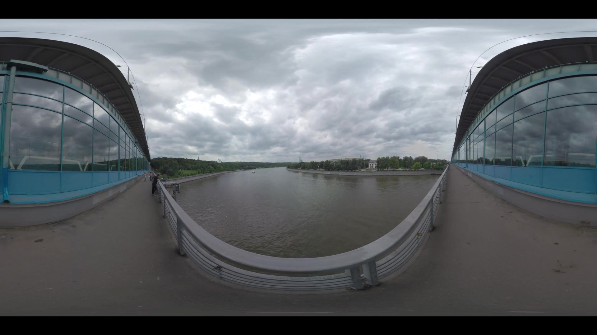 MOSCOW, RUSSIA - JUNE 21, 2016: 360 VR video. People walking across Luzhniki Metro Bridge with subway train running there. Cityscape with Moskva river. Metromost connects the neighbourhood of Luzhniki Stadium to Sparrow Hills