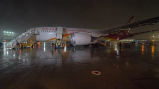 MOSCOW, RUSSIA - OCTOBER 31, 2017: Slow motion shot of deboarding aircraft of Hainan Airlines arrived to Sheremetyevo Airport at night. People walking down the airstairs