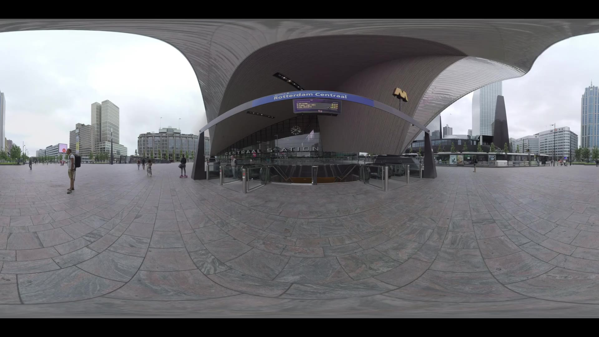 ROTTERDAM, NETHERLANDS - AUGUST 07, 2016: 360 VR video. Cityscape with Rotterdam Centraal entrance and people walking on the square in front of it