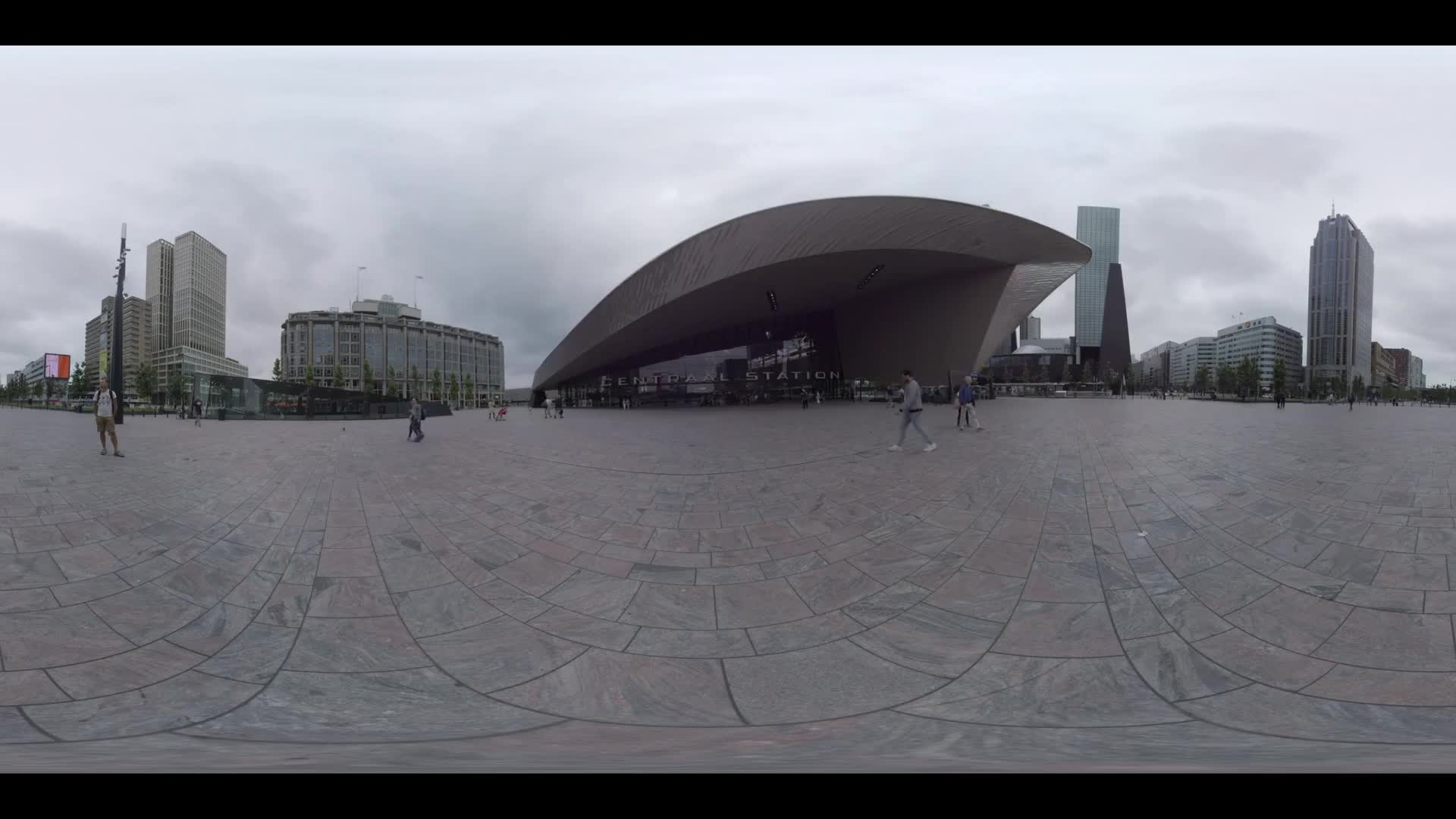 ROTTERDAM, NETHERLANDS - AUGUST 07, 2016: 360 VR video. People walking on the square in front of Rotterdam Centraal entrance. Cityscape with modern buildings