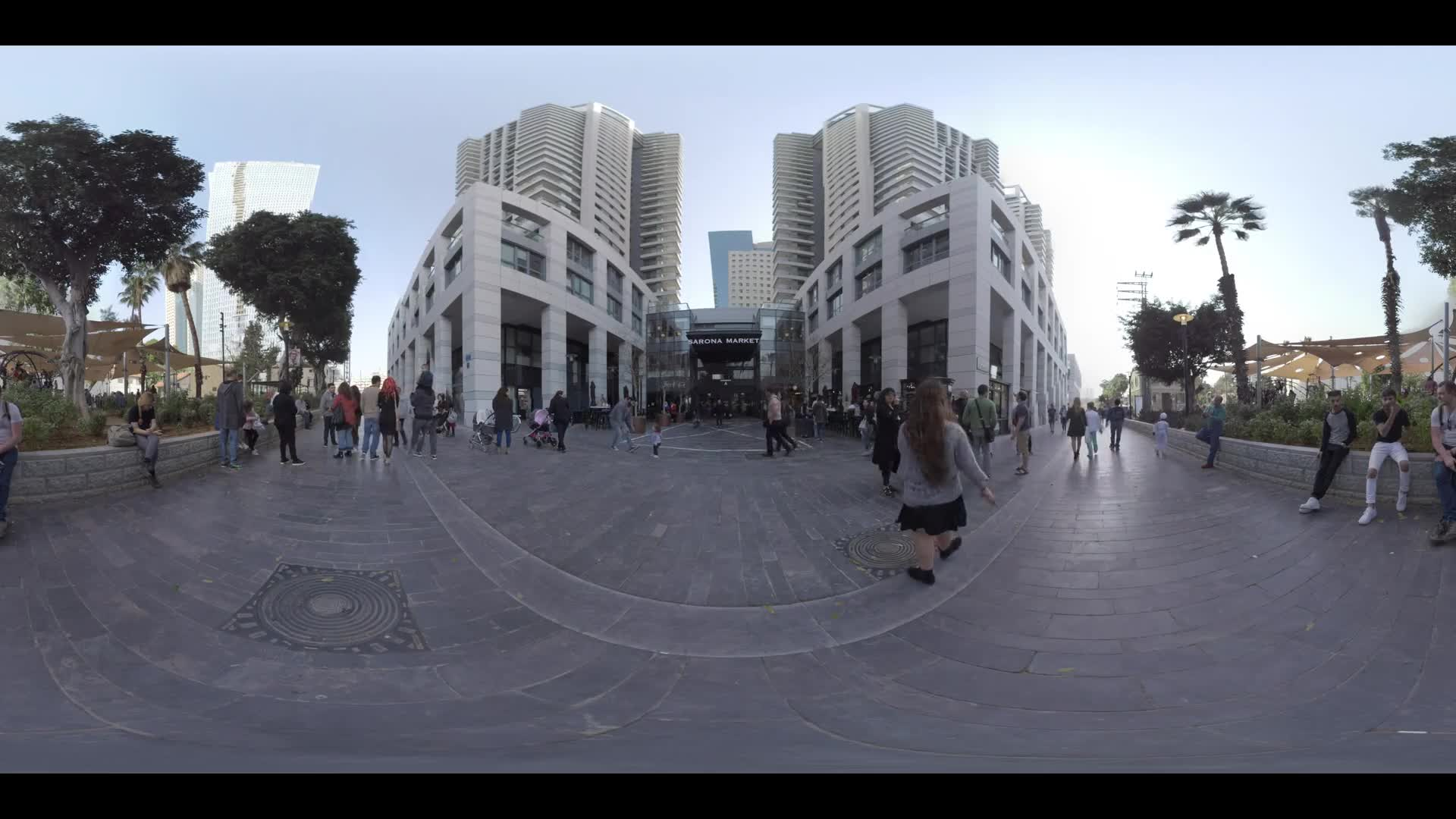 TEL AVIV, ISRAEL - MARCH 10, 2017: 360 VR video. View to Sarona Market building and people in the street and near the entrance. Israel largest, most unique indoor culinary complex with 91 shops, stalls and restaurants