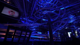 VIENNA, AUSTRIA - APRIL 26, 2016: View of interior of restaurant with lighting changing colors reflected on small rollercoaster along ceiling. Austria is visited by more than 25 million tourists