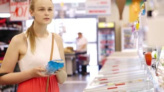 Young blond woman buying products at the supermarket