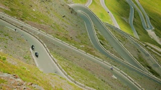 Car and motorcycle traffic on the scenic hairpins of the Stelvio Pass in the South Tyrol area of the Italian Alps.