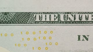 """Extreme closeup dolly footage of a one hundred dollars bill, showing the slogan """"In God We Trust""""."""