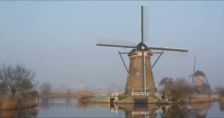4k time lapse panning footage of historic windmills at Kinderdijk, The Netherlands on a clear morning.