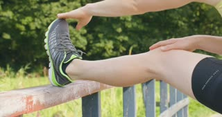 An active young woman stretching before a run in the park.