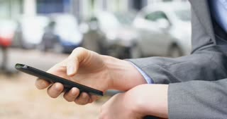 Businesswoman texting on a smartphone during break. Closeup, side angle shot.