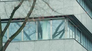 Closeup footage of an office building with small windows.