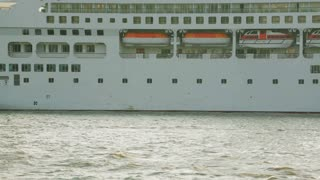 Closeup static footage of a docked cruise ship.