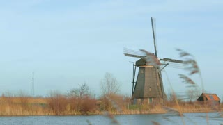 Historic windmill at Kinderdijk, Holland. Camera pan.