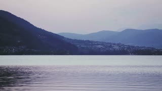 Lake Lago di Caldonazzo in Northern Italy - static footage on a late summer evening.