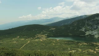 Panning footage of a panoramic view over the Dolnoto lake in the Rila mountain, Bulgaria.