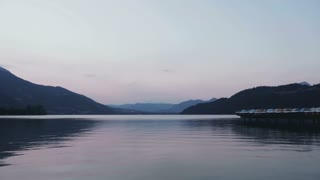 Panning footage of the Alpine lake Lago di Caldonazzo in Italy, shot in summer.