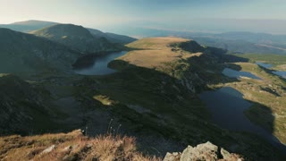 Panning panoramic footage of the famous Rila lakes in Bulgaria by sunset.