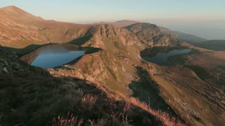 Panoramic view over a part of the famous seven Rila lakes in Bulgaria by sunrise.