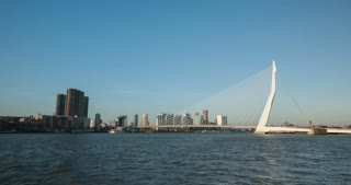ROTTERDAM, THE NETHERLANDS - FEBRUARY 6 2015: Time lapse view of the Erasmus bridge and city center with marine traffic on the New Meuse (Nieuwe Maas) river.