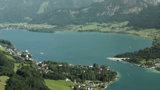 Scenic panorama pan over the Wolfgangsee lake in Austria on a warm summer day.