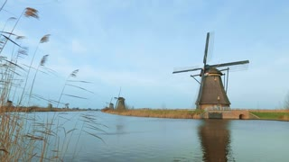 Scenic view of Dutch windmills at a water canal at Kinderdijk.