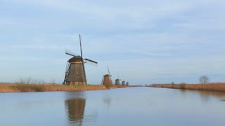 Scenic view of Dutch windmills at a water canal.