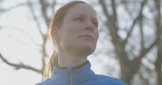 Slow motion portrait of a female athlete in a park.