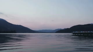 Static footage of the Alpine lake Lago di Caldonazzo in Northern Italy, shot by summer.