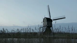 Stationary windmill in Kinderdijk, The Netherlands by early morning.