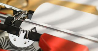 The beginning of a Dear John letter being typed on an old-school typewriter. Locked down closeup shot.