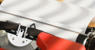 The first words of the Bible being typed on a 1970's typewriter. Locked down closeup shot.