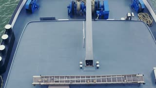 Slow motion top view of a container cargo ship sailing on a river.