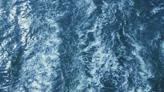 Water waves - top view in slow motion of blue water clashing.