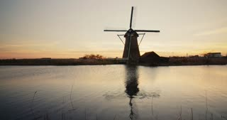 Windmill behind a water canal in Kinderdijk, The Netherlands.