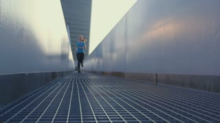 Woman running in a city. Slow motion shot.