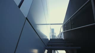 Woman running up stairs in a city.