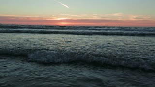 Water waves at the North Sea by sunset in the summer.