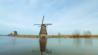 Wide angle static footage of windmills at Kinderdijk, Holland.
