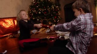 Children pulling Christmas cracker.