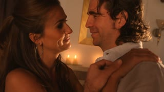 Couple dancing by candlelight