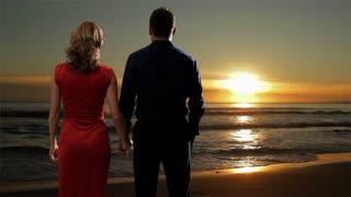 Couple embracing on the beach at sunset.