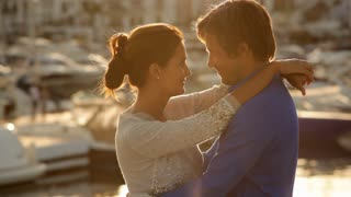 Couple Hugging by Marina in evening light